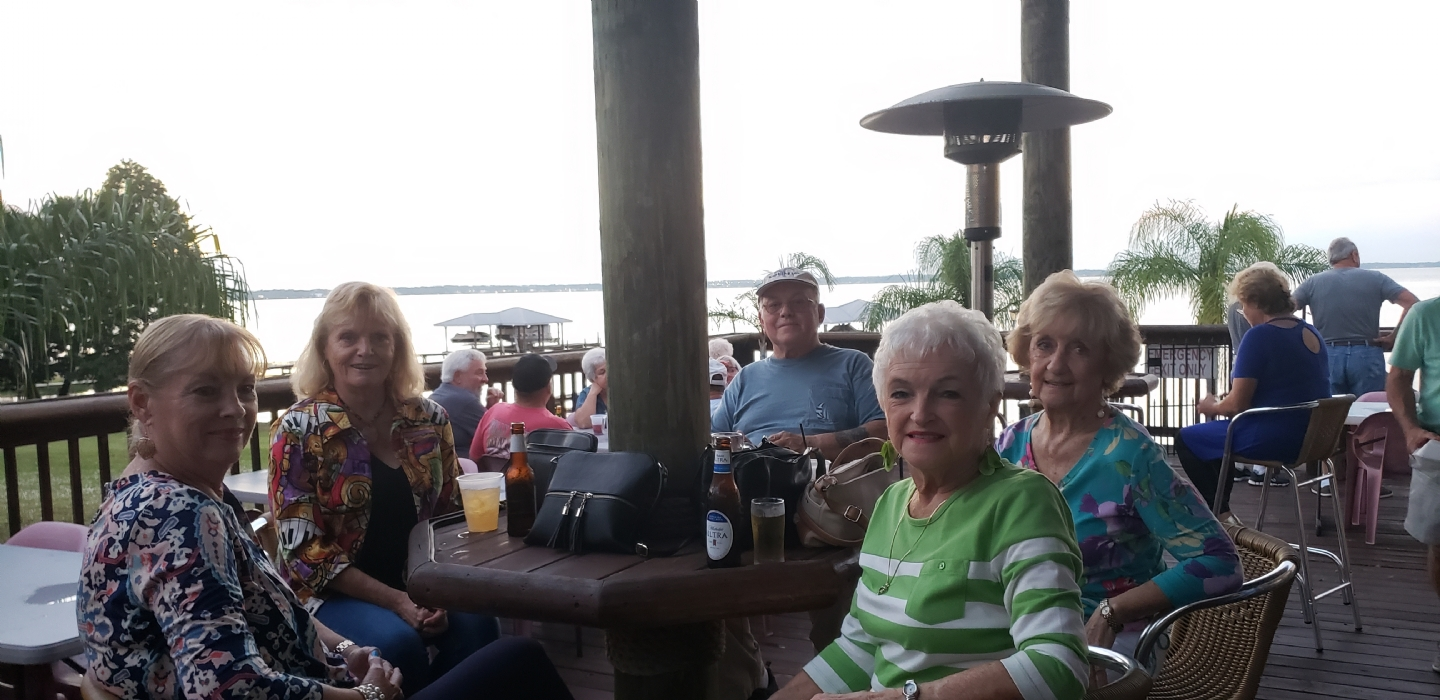 Members enjoying the outside tekki bar overlooking Lake Jackson.